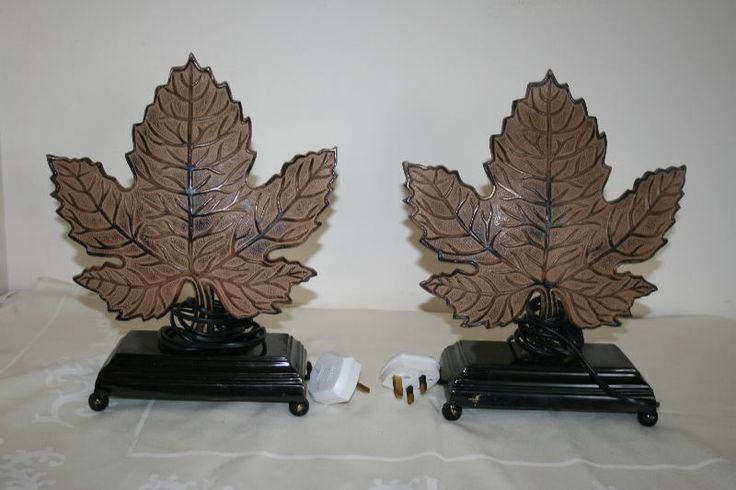 "A rare pair of cast iron art deco lamps. These have been rewired for safety, and work perfectly. The ""leaf"" design is in cast iron, and the base is a lighter metal, with round feet. Each lamp weighs 2.7kg, and stand 14 inches wide x 11 inches high. I havn't seen a pair of lamps like this anywhere on the Internet or elsewhere."