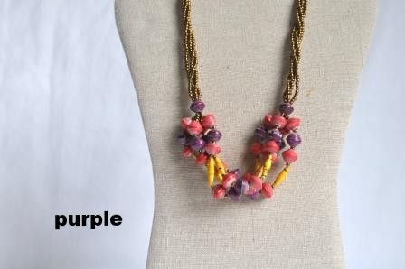 "Matooke Necklace - purple. This necklace is inspired by Ugandan traditional dish called ""Matooke"". The selection of colors allows playful and unique accessory to give some vibrant colors to a basic outfit. Made with strings with gold beads and recycled paper rolled beads. Available in two different color combinations that changes seasonaly."