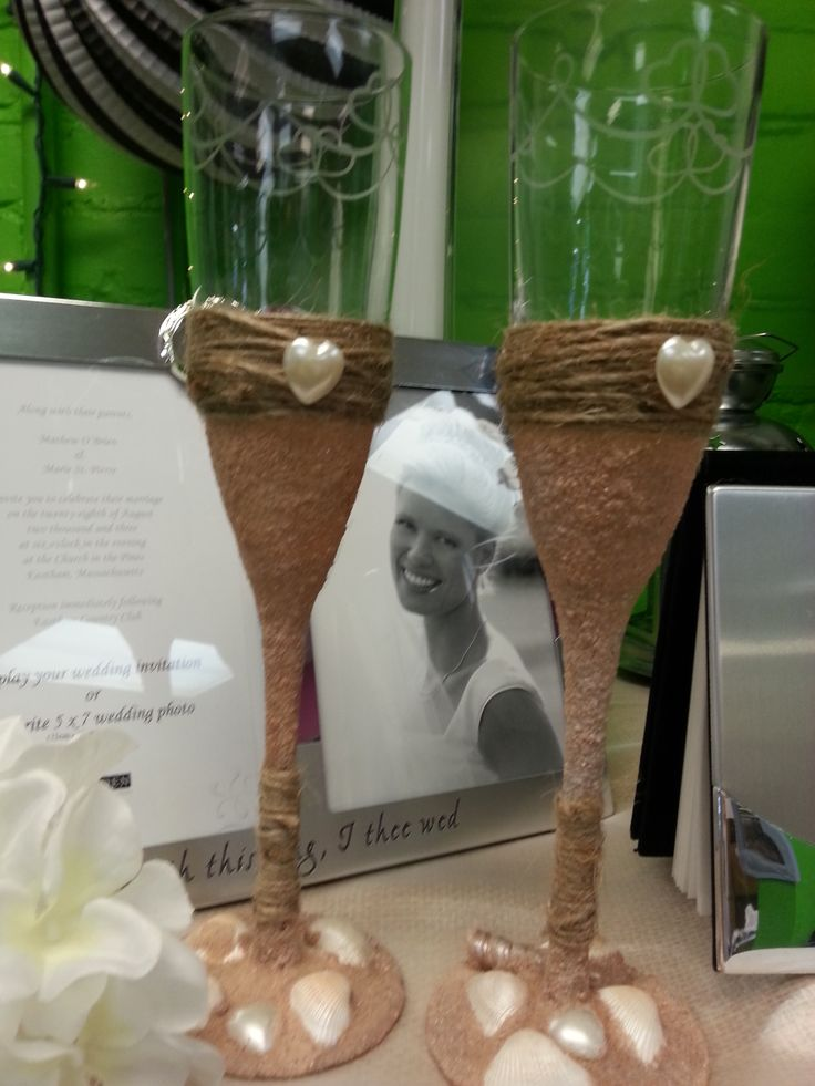 Hand made glasses with sand, shells and twine