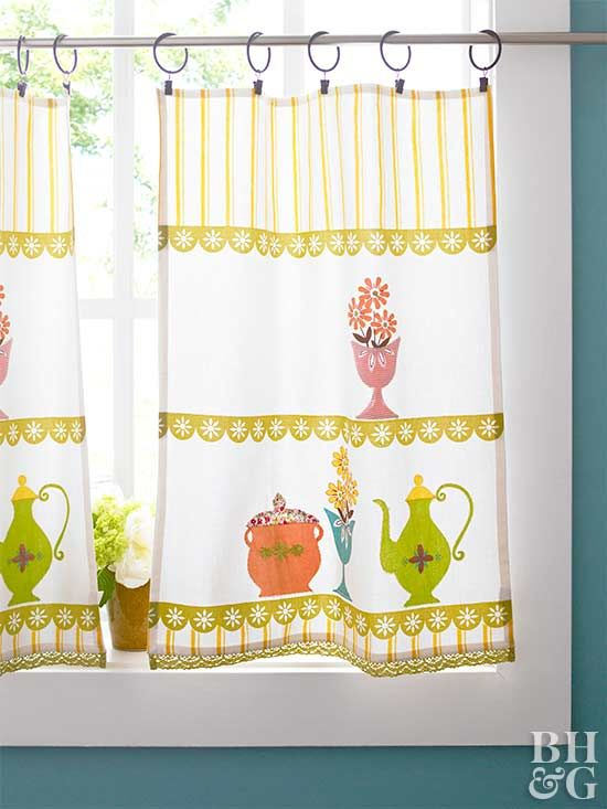 To create these pretty cafe curtains, purchase two 16x24-inch tea towels. Install curtain rods at your desired height. Attach ring clips to the top of the tea towels to hang them from the rod. If the towels hang past the windowsill, measure the fabric, cut off the excess, and hem the towels using a sewing machine or fusible web and an iron.