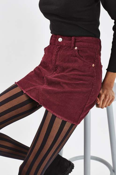 The staple MOTO high waisted skirt has arrived in cord form. Featuring five pocket detail in a mini cut, it comes in a wine hue. Best co-ordinated with a cord borg jacket. #Topshop