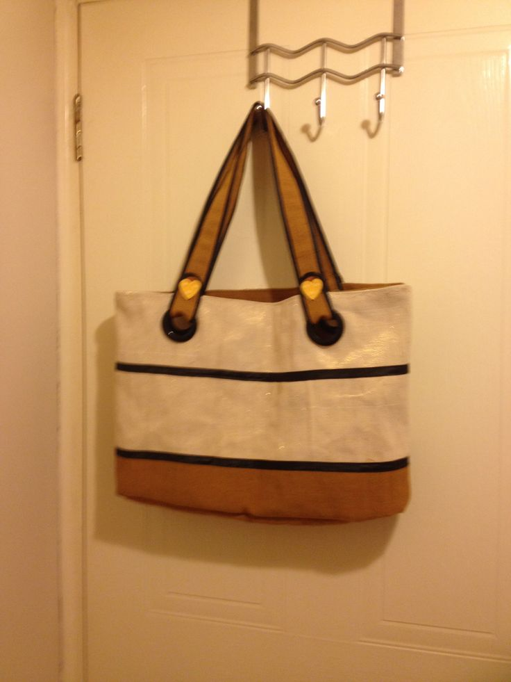 Fully lined and zippered tote bag made from Nigerian Aso-Oke cloth in gold threaded cream and brown strips