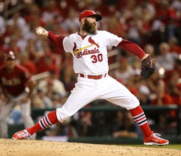 In his first outing since coming off of Tommy John, Jason Motte pitches in tenth inning action during a game between the St. Louis Cardinals and the Arizona Diamondbacks. May 21, 2014.