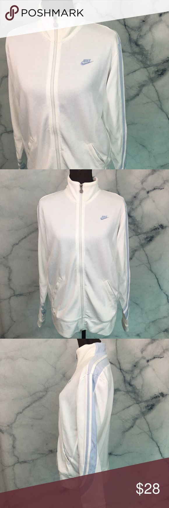 NWT Nike Track Jacket Zip Up Sweatshirt NWT Nike Sweatshirt Zip Up. White with light blue details. One mark shown in photos, haven't tried treating as this is new with tags. Tops Sweatshirts & Hoodies