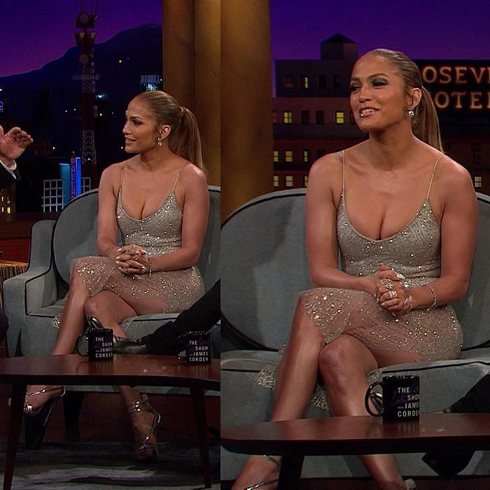 """Jennifer Lopez wearing a $110 Meshki 'Aviana' jeweled midi dress and silver strappy sandals on her guest appearance on The Late Late Show with James Corden"""" aired on May 5, 2017."""