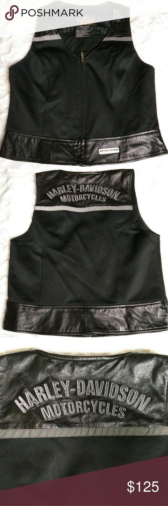 Harley Davidson Vest Fabulous Harley Davidson vest combo material, Shell 96% Nylon 4% Spandex, Genuine Leather trim, & 100% Polyester. Harley Davidson Jackets & Coats Vests