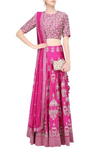 SVAs pink flared lehenga skirt in raw silk base embroidered with gold lantern motifs scattered all over the ghera. It has jaal pattern border around the hem and bunch of tassel hangings on the side. It is paired with pink raw sik blouse with gold floral aari and pita embroidery all over the front and back. It comes along with pink net dupatta with scalloped border.