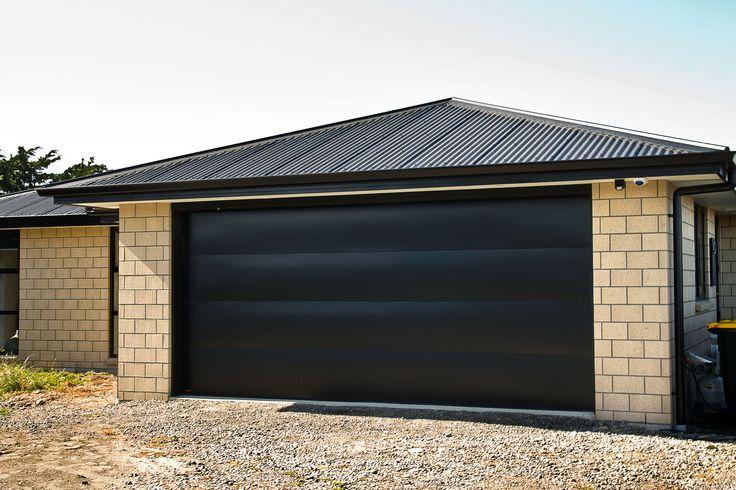 Dominator Valero Sectional Door in Pitch Black
