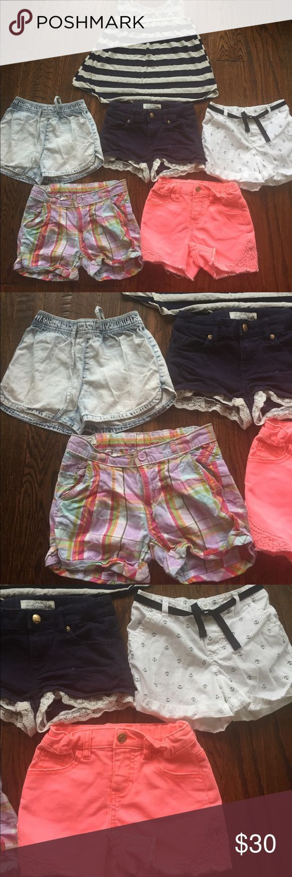 Girl Sz 6/7/8/S Shorts Bundle Clothing Lot This is a lot of Girls 5 pairs of shorts and one tank top. Carters White Blue anchor shorts Sz 6. Crazy 8 pastel Plaid shorts Sz 7. Squeeze faded Blue Denim shorts Sz 7. LOGG Navy Blue White Lace Trim shorts size 8-9 year. Cherokee bright orange Jean shorts Sz S. Most are adjustable waist of elastic waistband. Btween Tank top is a Size S. All in great condition with no flaws. Bottoms Shorts