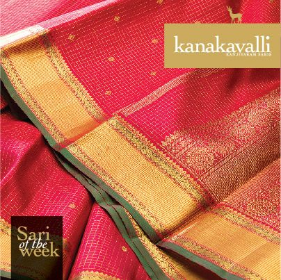 Zari checks on rich red silk create a captivating pattern, further embellished by bhuttas and diamond motifs . The pallu features a spectacular spread of zari woven with paisleys, vanki weaves, chakrams, bhuttas and leaf motifs.The green tinged border creates an ideal, traditional contrast that makes this Kanakavalli Kanjivaram a perfect expression of beauty.