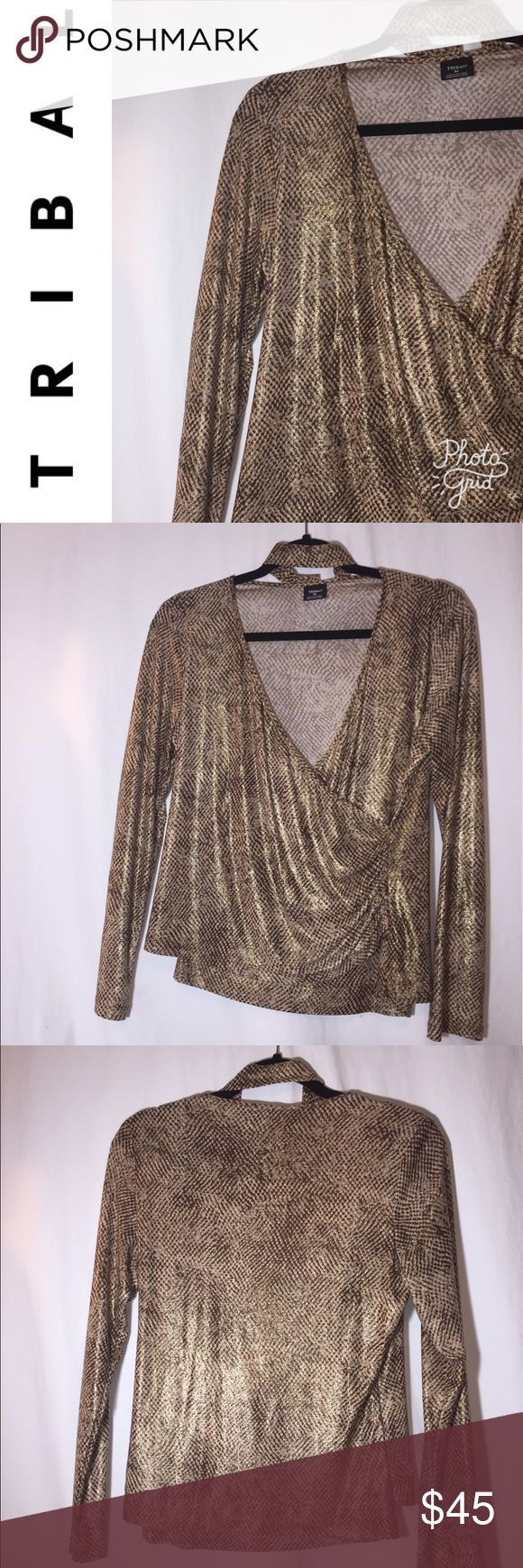 Tribal snake skin top. Size M Tribal snake skin wrap top. Size M. Comes with matching tie. Length 22 inches Sleeve length 24 inches Armpit to armpit 19 inches Tribal Tops Blouses