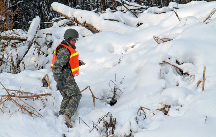 Officer candidates from Michigan National Guard brave the elements.Officer Candidate Sarah Barnes treads through deep snow in search of points she plotted earlier during land navigation for phase zero of the accelerated Officer Candidate School at Fort Custer out of Augusta, Mich. (U.S. Army photo by Spc. Brandon Ames/Released)