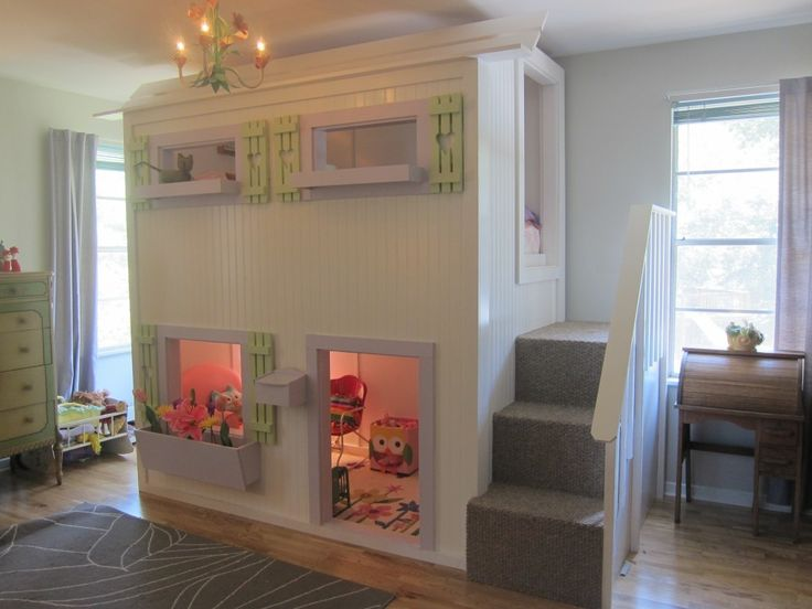 Playhouse loft bed for little girl. Purple and white with green shutters. Mailbox, flower box, shutters with heart cut outs, purple mirror, chandelier, stairs with railing, playhouse under the loft.