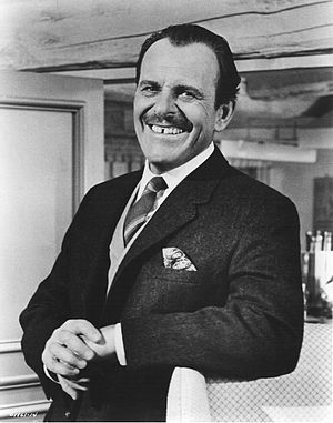 Terry Thomas (1911 – 1990) was an English comedian and character actor who became known to a worldwide audience through his many films during the 1950s and '60s. He often portrayed disreputable members of the upper classes, especially cads, toffs and bounders, using his distinctive voice.
