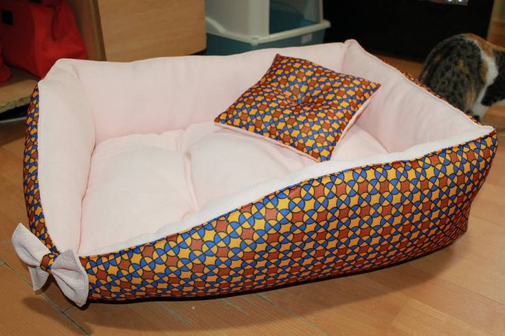 Handmade bed for small size dogs, manually sewn and finished, made from resistant materials, size 67/54 cm, hight 23 cm, filled with silicone fluff and comfortable for any furry pets. Removable cushion with 2 sides. Unique design!  The rectangular shape of the bed and high margins are ideal for squatting and provides a sense of security for the pet.The bed is washable at 30 ° C.