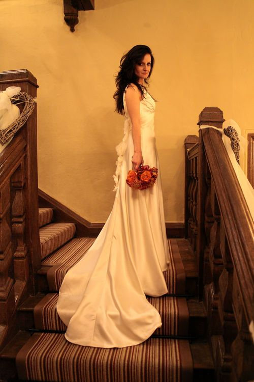 Stunning bride on a country house staircase