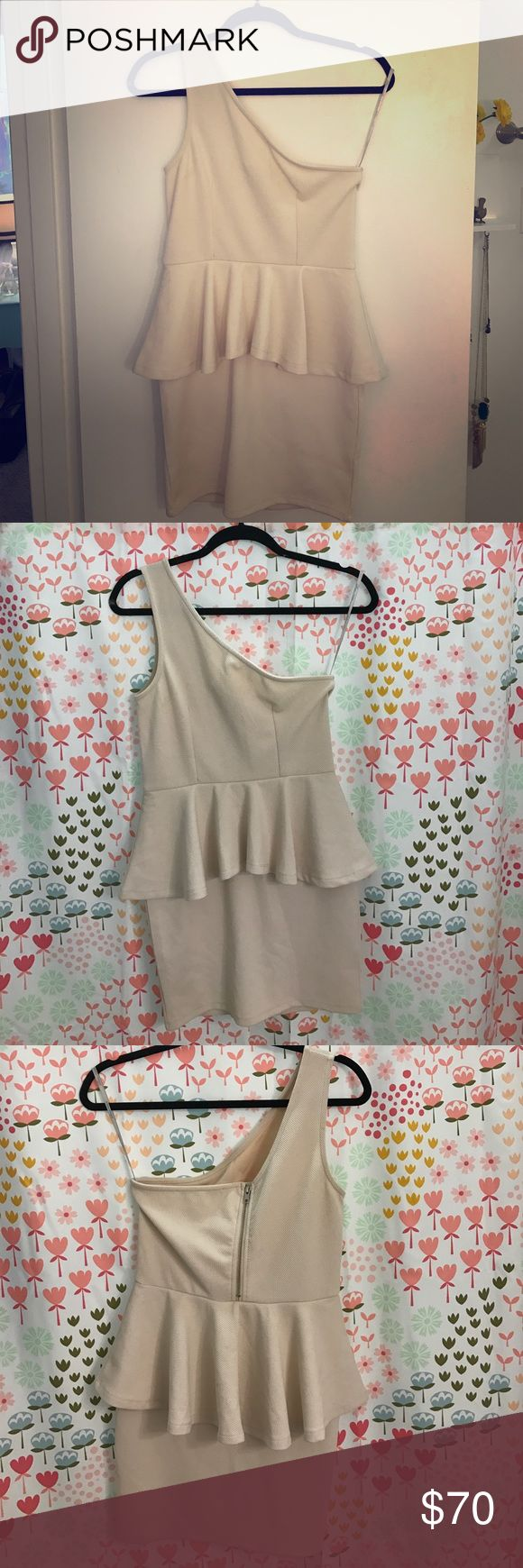 Lovers + Friends One Shoulder Cream Peplum Dress Great going out dress!! 👠👠 Polyester and spandex. Has stretch. One little spot on the back-- barely noticeable Lovers + Friends Dresses Mini