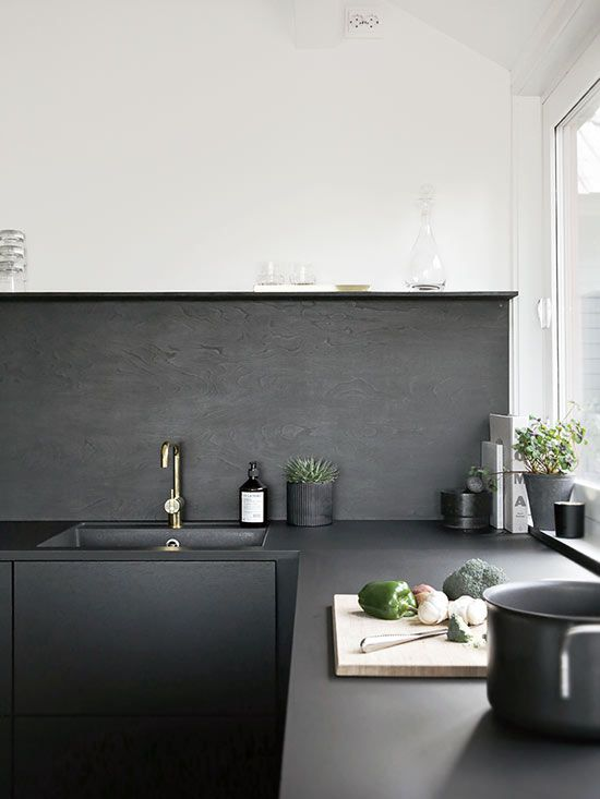 If contemporary design is what you're after, consider adding purely utilitarian surfaces, like concrete kitchen countertops, throughout your space. The material is eco-friendly and affordable, and when painted or sealed in a sleek color, like the matte charcoal counters featured in this kitchen, the look feels fresh yet approachable./