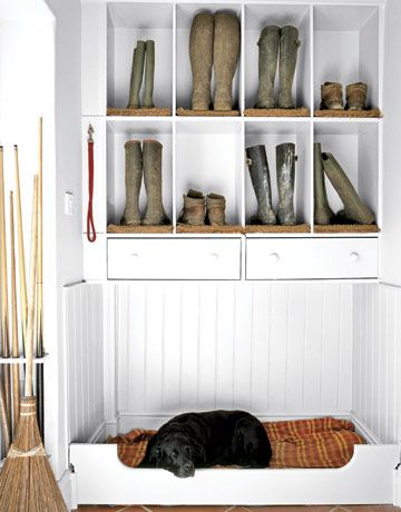 A mudroom with a built-in dog bed. Love the leash hook there too! Great idea to keep everything your pet needs in one space instead of scattered all over the house.  want tile floors, and a place to put dog crates, dog food, and dog bed...also want a doggy door to the outside from mudroom.