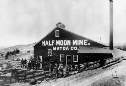 "Miners working the day shift pose in front of a building painted with the sign: ""Half Moon Mine, Matoa Co"" Teller County, Colorado. - June 4, 1898.: Building Paintings, Half Moon"