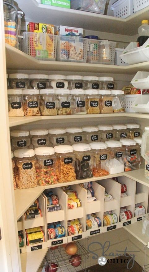 Superb pantry organization featuring clear canisters with chalkboard labels as well as space-saving shelves for cans. Kudos!    shanty-2-chic.com