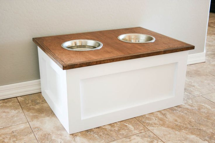 Keep your dog's food fresh and out of the way with this DIY dog food station with storage. The project includes free printable plans by @Addicted2DIY1 too! http://spr.ly/6490BFdIE