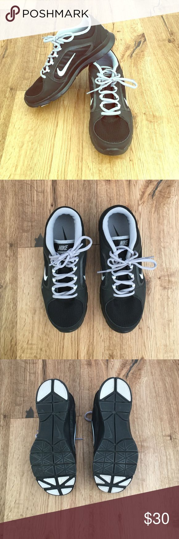 Nike Trainers Black and White Womens Sz 8 Barely worn, practically new Nike Trainers. Nice and sturdy. Very clean, no scuffs or stains. Size 8. Black with white check and gray inside. Nike Shoes Athletic Shoes