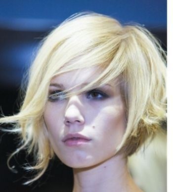 Wavy bob, with a cool asymmetrical edge to it. very nice. needs color though, I think.