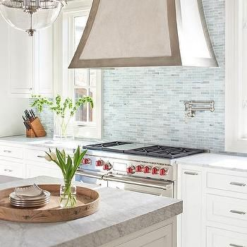 range hoods with a little trim are a great way to add a unique style to your kitchen