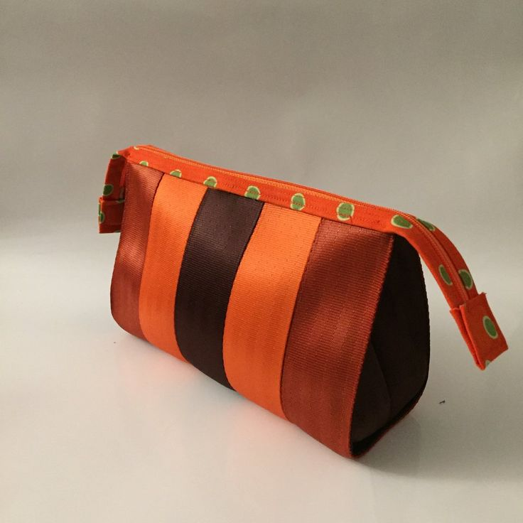 Make a statement and travel in style with our Seat Belt Savvy designer Cosmetic Bag. Handcrafted from durable seat belt material with coordinating lining. Zip