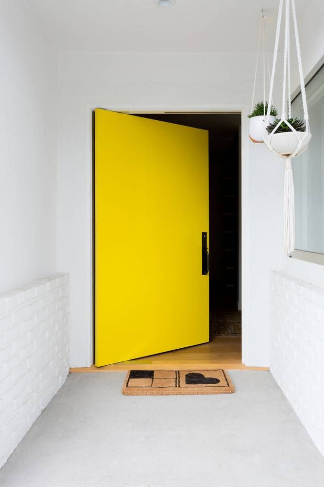 Minimal doesn't mean no color. A pop of bright yellow to greet you at the front door.