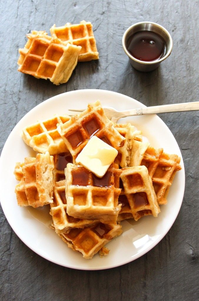 Melt-In-Your-Mouth Homemade Waffles | This is a recipe for our favorite homemade waffles – slightly crispy on the outside, and so light and fluffy on the inside that they melts in your mouth. These are the ULTIMATE homemade waffles. @byjenandemily