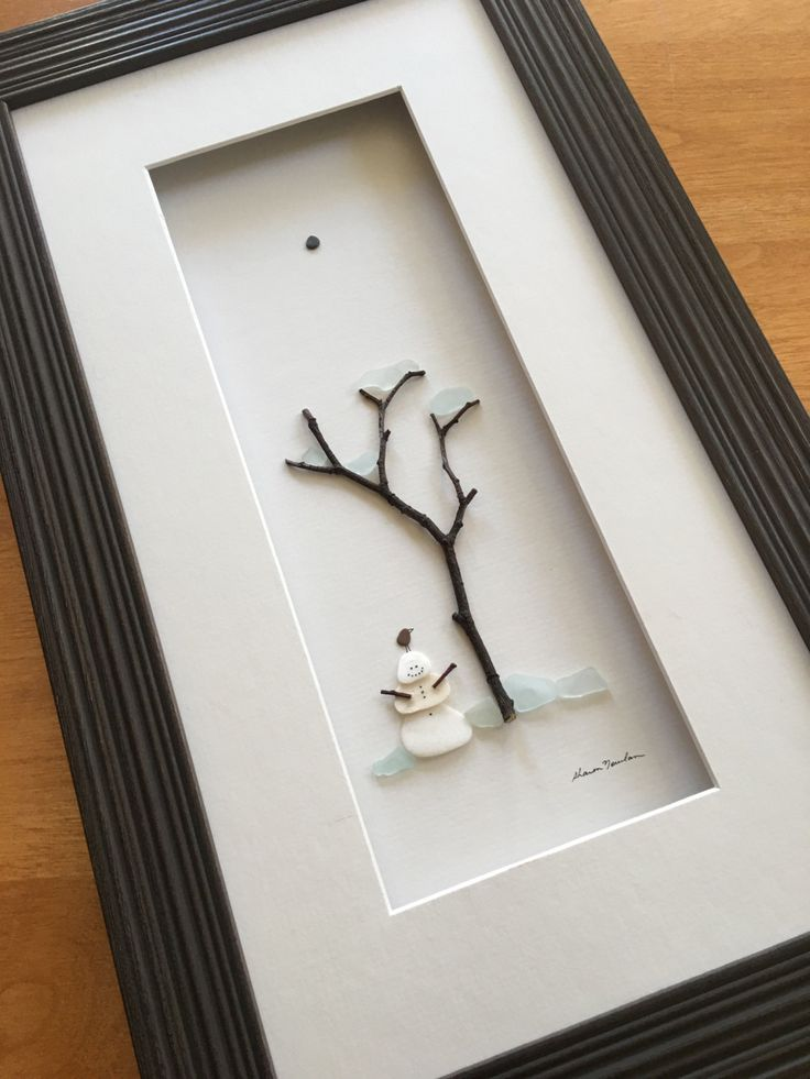 Pebble art of winter scene with tree and snowman by by PebbleArt