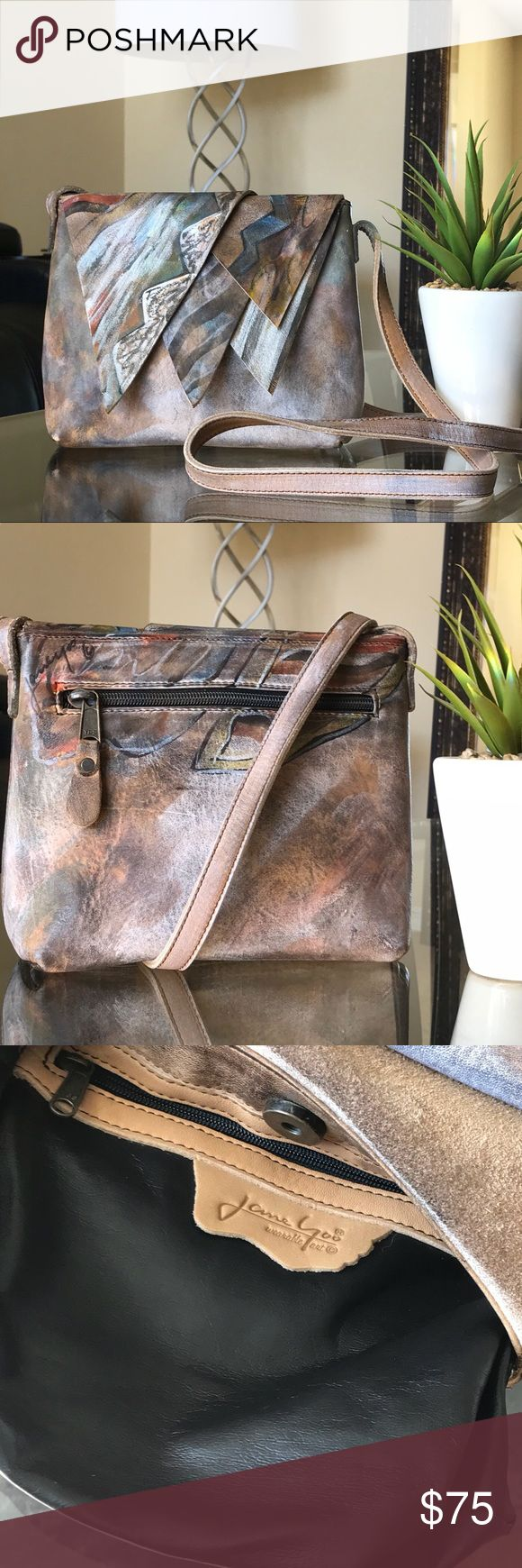 """✨JANE YOO wearable art 🎨Leather Hand Painted Bag✨ ✨👜 Designer JANE YOO wearable art✨🎨 100% Leather """"Hand Painted One-Of-A-Kind"""" Crossbody Bag. Color: Tan/Metallic/plethora of other Earth-Toned colors(Please refer to pictures). Condition: In EUC❣️ Crossbody features: (1)Exterior zip pocket and (1)Interior zip pocket. Asymmetrical flap opening, secured by a strong magnetic closure. Approximately 7.25""""W x 6.25""""L x 2.76""""D. Approximately a 21.5""""L Strap Drop. This style & design is truly…"""