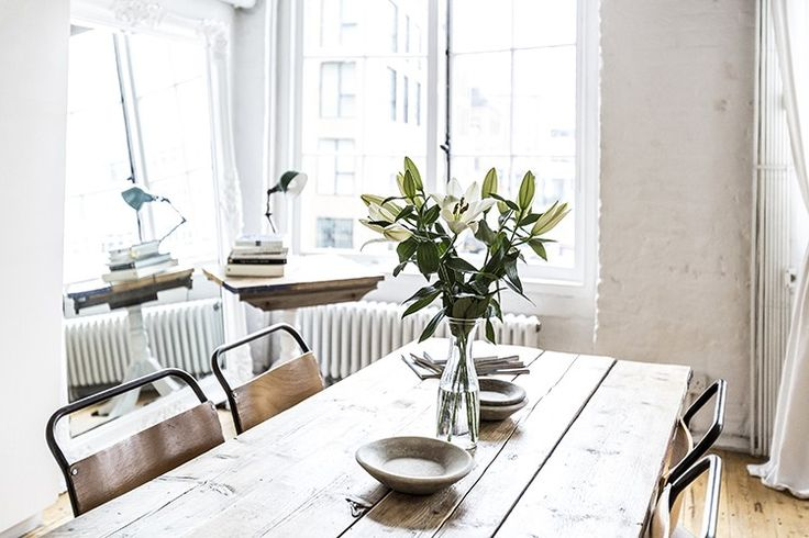 Scaffold boards from a local building site on top of a simple trestle frame form the dining table