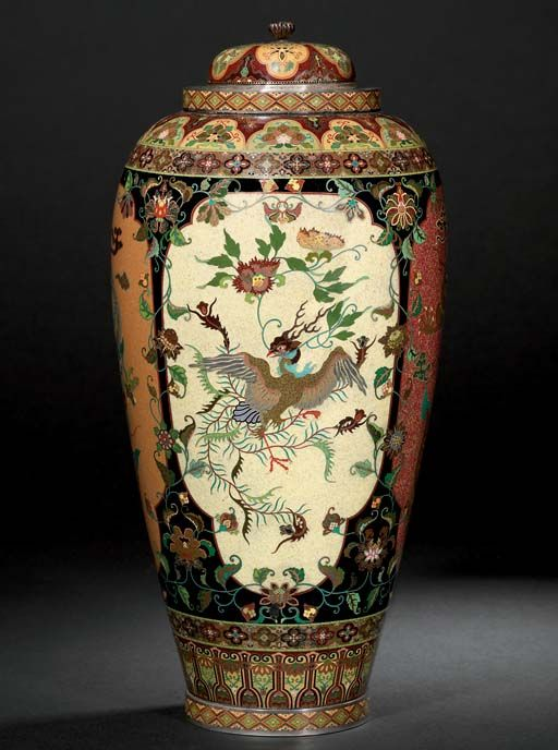 A MAGNIFICANT CLOISONNÉ VASE WITH COVER  SIGNED KYOTO NAMIKAWA, MEIJI PERIOD (LATE 19TH CENTURY)  Worked in various thicknesses of gold and silver wire and coloured enamels, goldstone and translucent enamel on various mottled grounds with panels of dragons and ho-o birds bordered by entwined floral vine on a black ground between bands of brocade design, the domed cover similarly decorated, silver mounts 34.5cm. high
