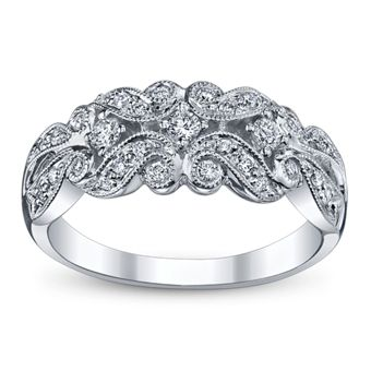A stunning vintage styled anniversary ring. This Utwo wedding anniversary ring is showing off 31 round diamonds. Sku: 0355058