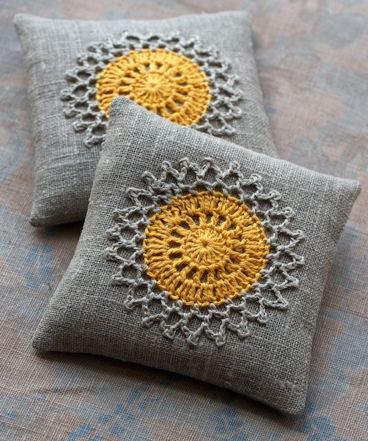 find yellow doilies (or dye?) sew on grey pillows