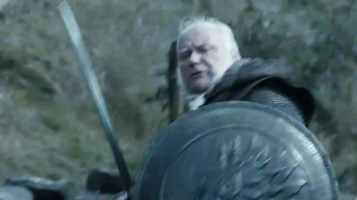 Here's Ser Rodrik fighting on the High Road, taking out a wildling. He's carrying the round, wolf's head shield of the Stark guard, which is a little surprising. In the novels, of course, his travels with Catelyn are carried out in secret. Carrying such a piece of equipment would surely raise eyebrows and undermine the secrecy. Presumably, in the TV show, Rodrik carries it under a cloak or something to prevent this from being an issue.  We'd love to see Ron Donachie get more work, and I've…