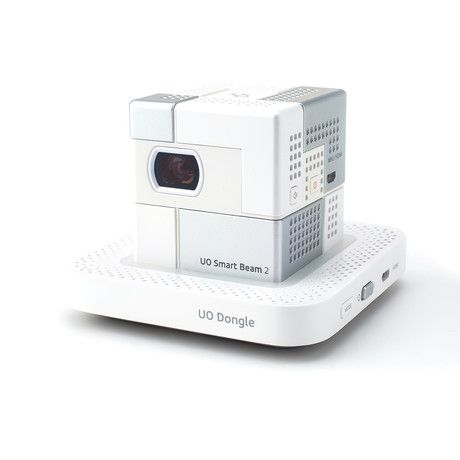 Do you like slowly falling asleep in bed while watching a movie, or want to bring more entertainment into a room with no TV? These are the benefits of the Smart Beam and WiFi Dongle, a pocket-sized projector in a powerful little package. Its cube ...