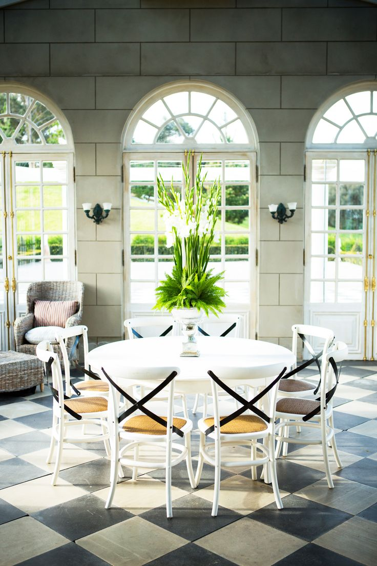 206 best dining spaces images on pinterest dining room dinner an elegant dining room in a opulent home with high ceilings vast arched windows white dining tableelegant