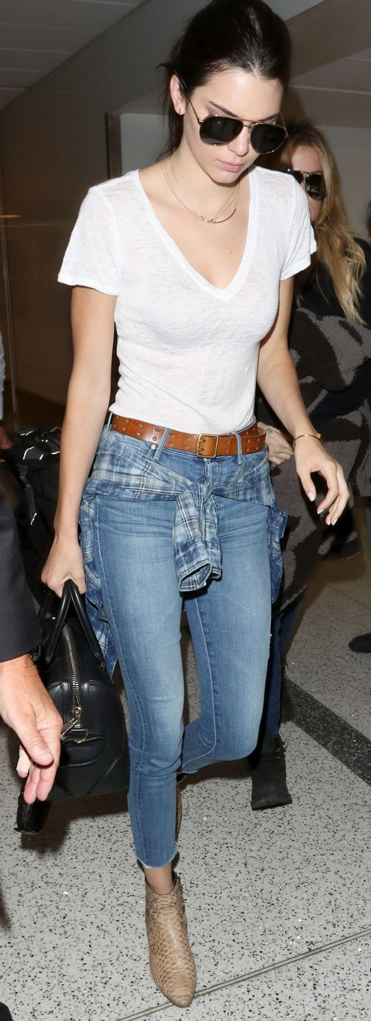 Kendall Jenner in Black Orchid button down, cropped jeans, and ankle booties.