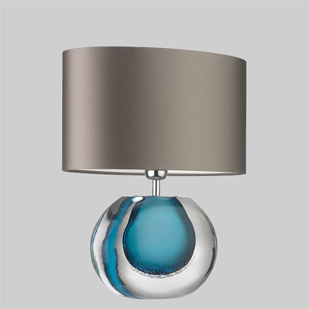 The Gaia lamp is hand blown by master craftsmen. The drop of intense velvet amber colour gives this smaller lamp a polished elegant feel. This design is individually crafted and will vary from piece to piece; providing a unique and timeless product.