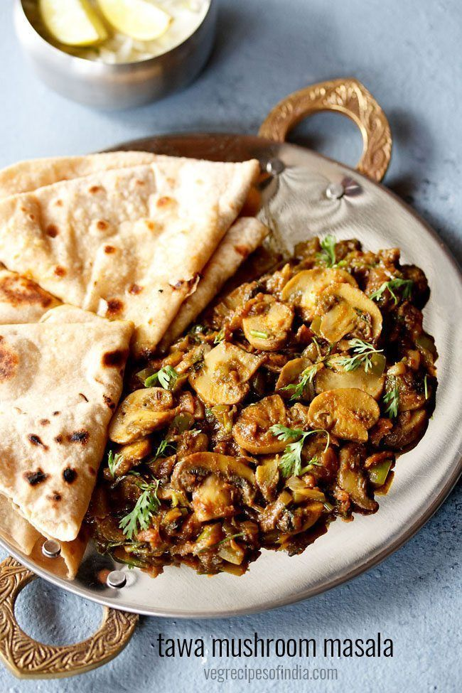 tawa mushroom masala recipe with step by step photos - a delicious recipe of tawa mushroom masala where button mushrooms are cooked in a spiced onion-tomato based gravy.    tawa in hindi means a concave shaped pan.