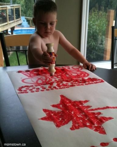 #PCCanadaday Canada flag craft - one big one made by everyone.  cover the white areas while they are dabbing the red then peel it off - use a big sheet of laminating film