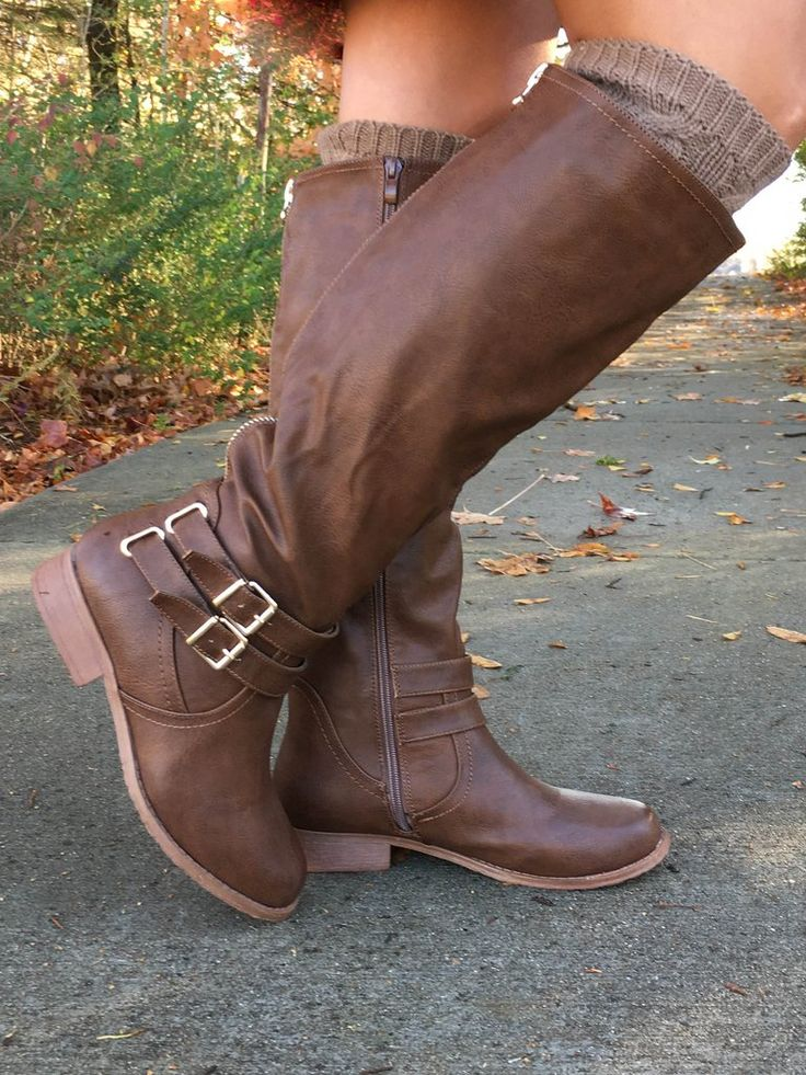 "These classic, knee-length riding boots are a staple in every stylish girl's closet. The comfortable 1"" heel, buckle detail, decorative back zipper and side zip closure makes these the perfect everyda"