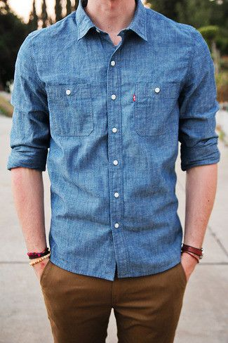 Opt for a blue denim shirt and tobacco chinos for a casual level of dress.