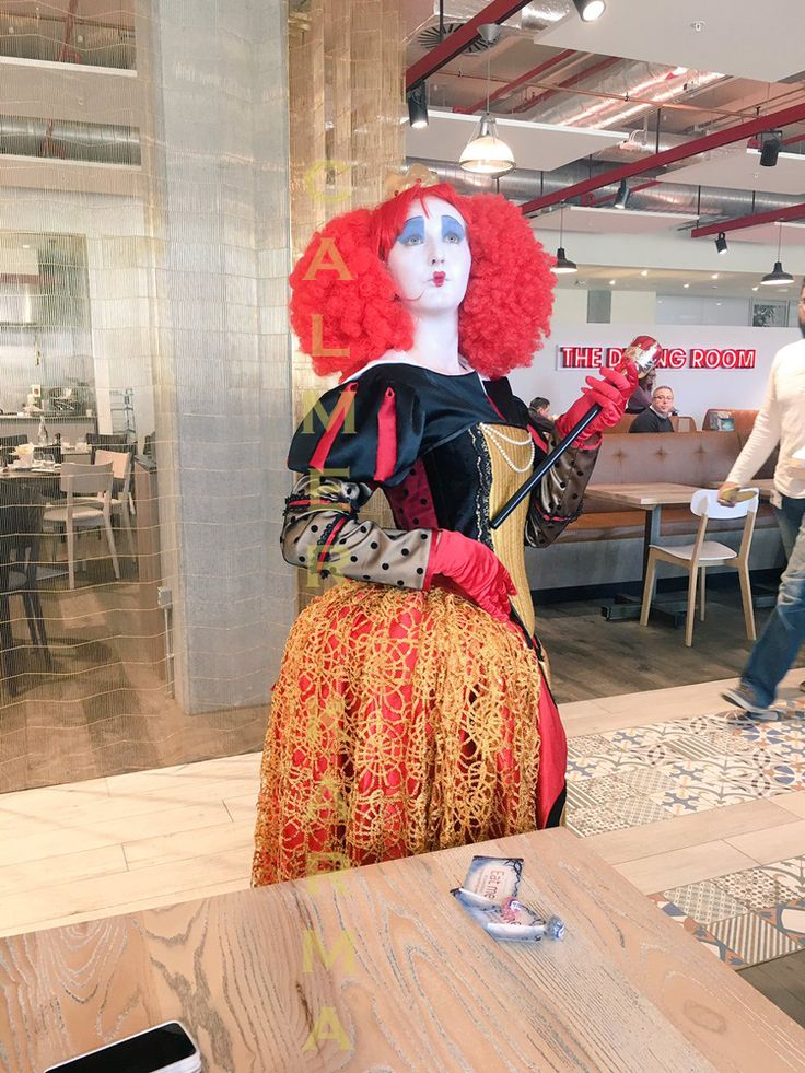 Red Queen lookalike posing for photos and entertaining Sky TV staff over lunch.  Disney approved costume. Available to hire across the UK inc Manchester, London, Birmingham, Brighton.