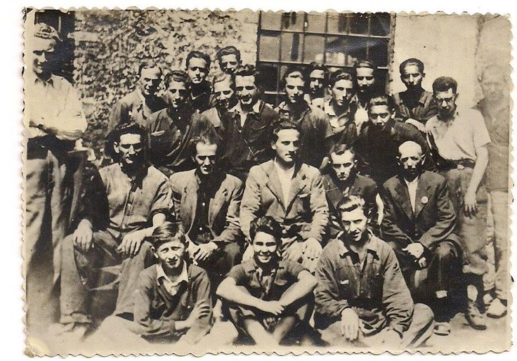The untold story of a picture. My Grandfather, Pinchas Meilman (first row, right) at Moghilev, Transnistria labor camp, during World War II.