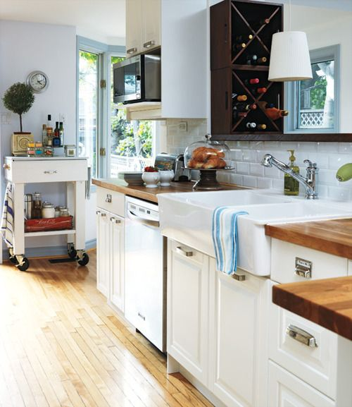 beautiful white kitchen, tiles, cart and wine rack